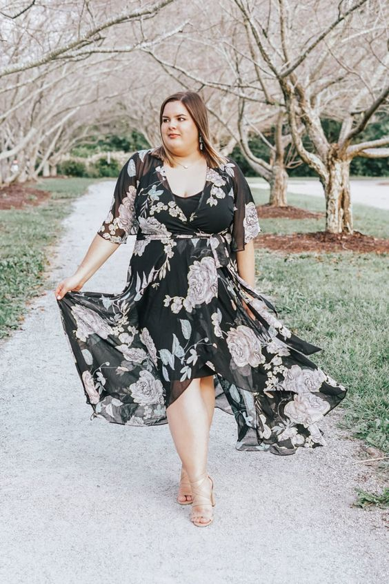 a moody floral midi dress with a deep neckline and pale floral prints is a chic idea for a spring wedding