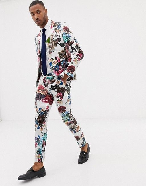 a bright floral skinny suit, a white shirt, a black tie and black moccasins and no socks for a summer look