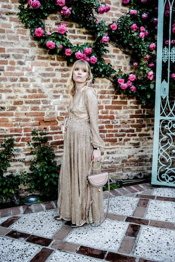 a glam sparkling gold maxi dress with long sleeves, metallic heels and a cute blush bag are pure elegance