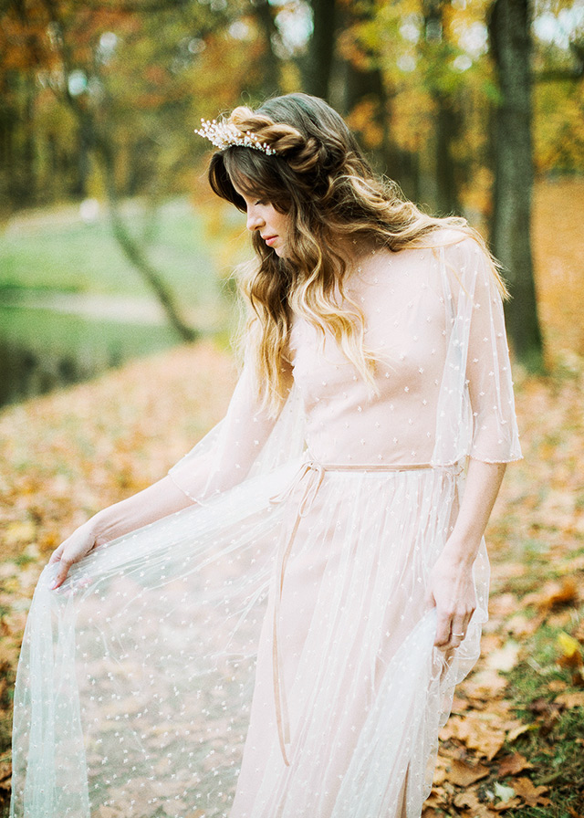 a nude wedding gown with a polka dot overdress with long sleeves and a velvet sash for a tender bridal look