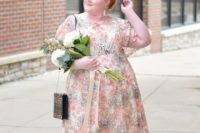 14 a stylish floral midi dress in muted shades, with short sleeves, black shoes and a leopard bag