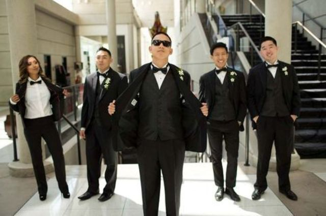 the whole party wearing black tuxedos and bow ties including the groomslady