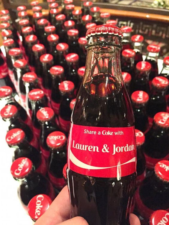 personalized Coke bottles with your names will refresh your guests on a hot summer day