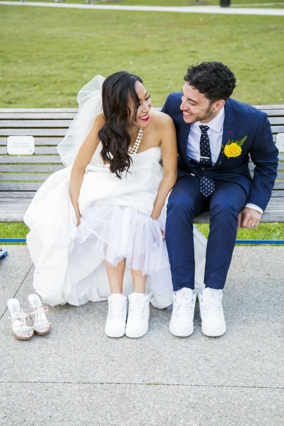 the bride can change her gorgeous heels to the same white sneakers as the groom to feel comfy while walking