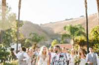 16 a daring groom's look with a white floral print suit, a white shirt and dark shoes is wow