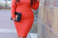 16 an orange cold shoulder midi dress with long sleeves, tan shoes and a black and gold clutch