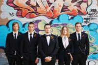 16 black suits for everyone, black ties for guys, a bolo tie for the lady and chic heels