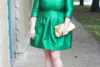 17 an emerald high neckline over the knee dress with long sleeves, nude shoes and a metallic clutch