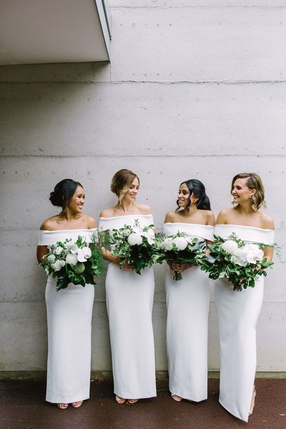 white plain off the shoulder maxi bridesmaid dresses create a bold minimalist bridal party look