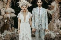 18 a light blue floral print three-piece suit with cropped pants, amber boots and a bolo tie for a daring look