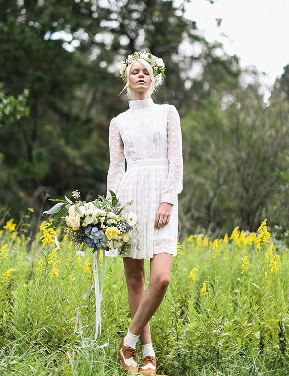 a super modern and playful polka dot wedding dress with a turtleneck and long sleeves plus Oxford shoes