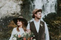 18 both guys wearing brown hats for their mountain elopement, a touch of boho for their attire