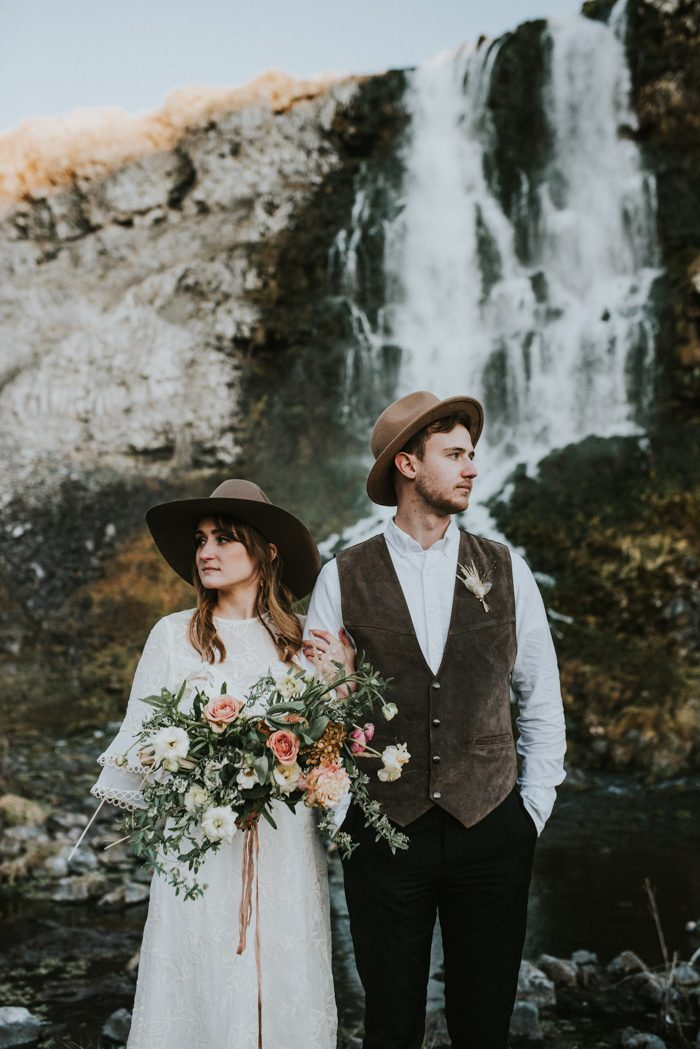 both guys wearing brown hats for their mountain elopement, a touch of boho for their attire