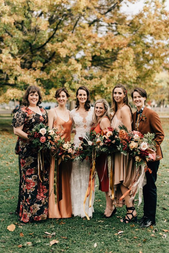 touches of rust in bridesmaids' outfit - a jacket and a silk dress for a wow look