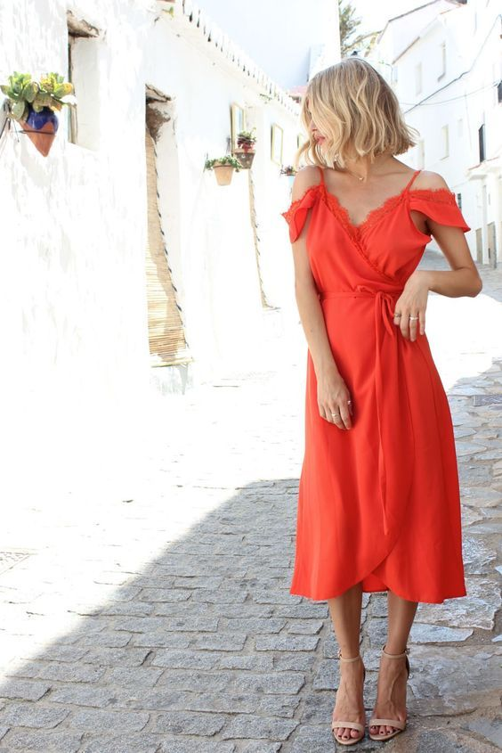 a cold shoulder wrap dress in bold orange and nude shoes for an effortlessly chic wedding guest look
