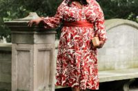 19 a red and white floral print midi gown with long sleeves, tan shoes and a small clutch