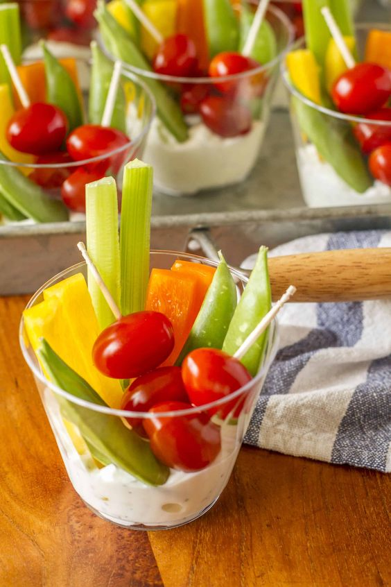 individual veggie cups with some dip are a perfect and super healthy appetizer for any occasion