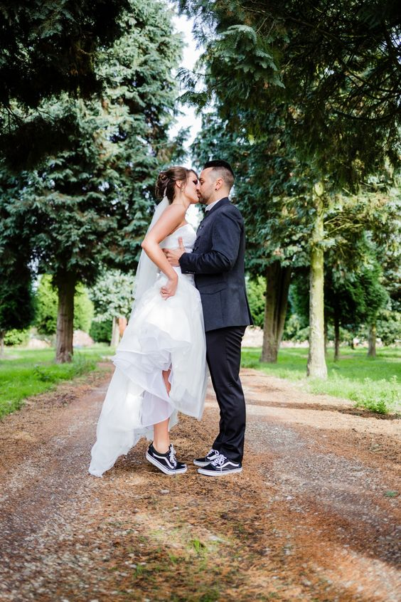 matching black Vans sneakers for both is a cool idea to wear on your big day