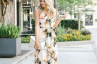 20 a creamy floral print wrap maxi dress with a V-neckline, metallic shoes and a metallic envelope clutch