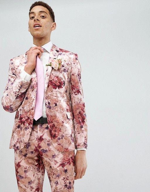 a pink floral suit, a white shirt and a pink tie for a bright summer wedding