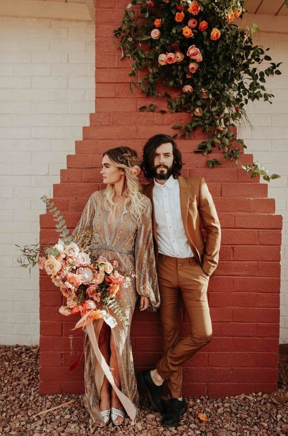 a rust colored suit, black shoes and a white shirt is a chic outfit for a boho chic wedding
