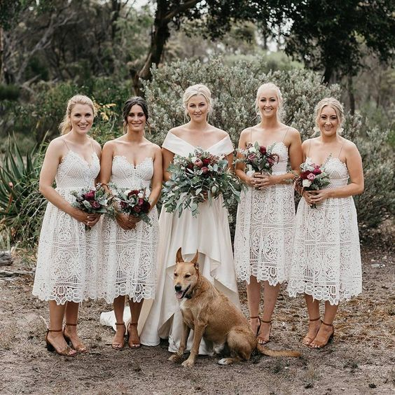 white lace midi bridesmaid dresses with spaghetti straps are comfy to wear and give a boho retro feel