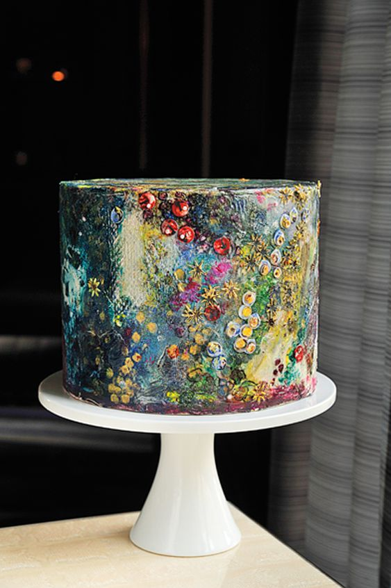 a moody handpainted wedding cake with lots of small blooms looks like a real masterpiece