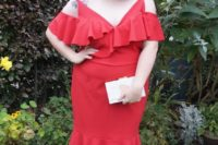 21 a red midi dress with a ruffled neckline, a cold shoulder, metallic shoes and a small white clutch