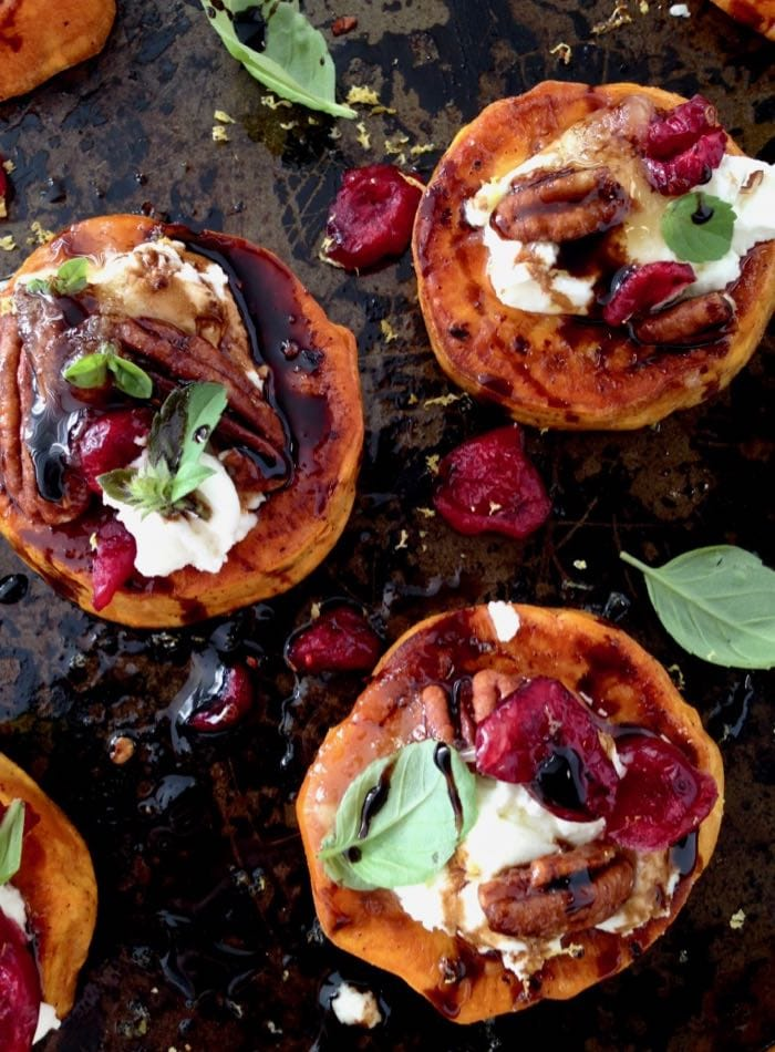 roasted sweet potato rounds are loaded with vegan goat cheese, cranberries and balsamic glaze