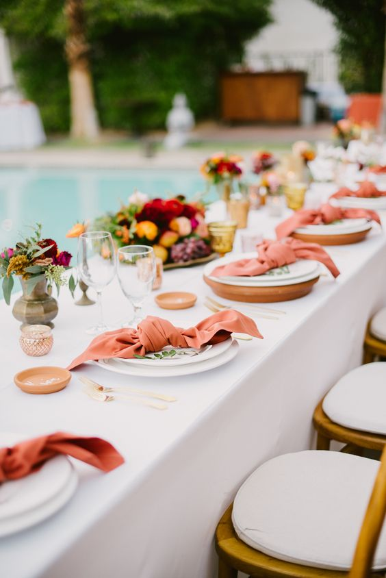 rust colored napkins and candle holders will immediately raise your tablescape to a new level