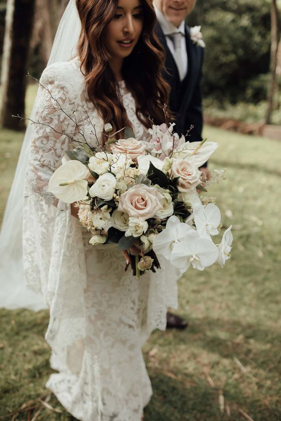 a chic neutral bouquet with blush and white blooms including anthuriums for a unique look