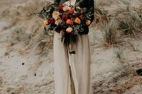 22 a neutral wedding gown accessorized with a black leather jacket and a black hat for a highlight
