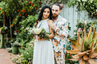 22 a super colorful florla suit with a white shirt and no tie, amber shoes for a colorful tropical wedding