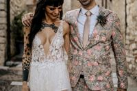 23 a tan suit with a pink floral print, a white shirt, a tan silk tie and a hat to make a statement