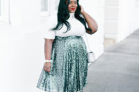 24 a white turleneck with short sleeves, a green high waist sequin midi, black shoes and an off-white bag