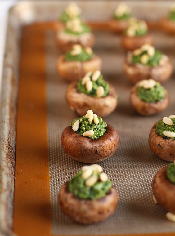 vegan pesto stuffed mushrooms with nuts on top are a great idea of bite-size food