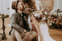 25 a brown hat and a matching leather jacket plus boots are cool to pull off a stylish boho groom's outfit