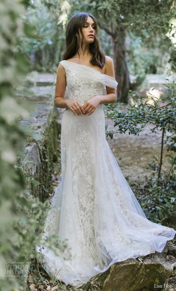 a chic one shoulder (asymmetric) lace wedding dress with a tulle overskirt
