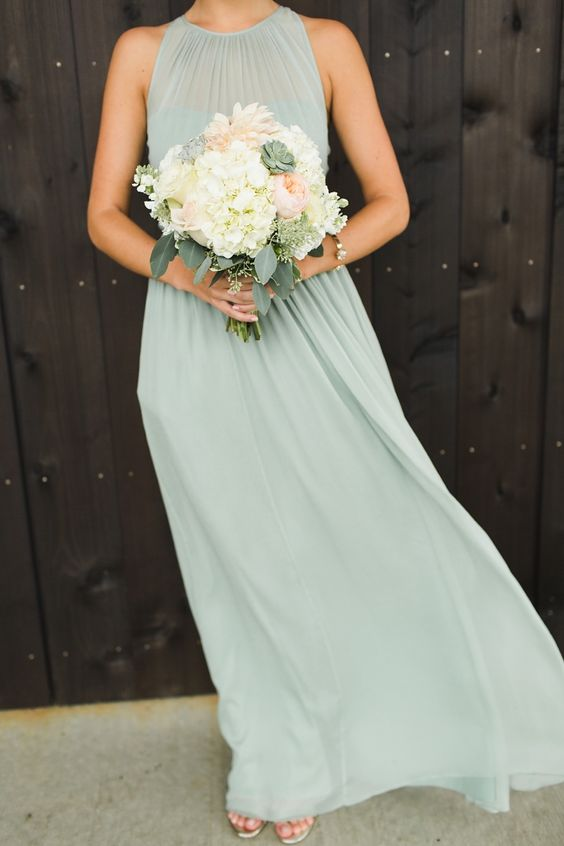 a modern pastel green bridesmaid dress with a halter neckline and slight pleating