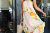 25 a pink floral print halter neckline maxi dress with nude shoes and a wicker basket bag for a fashion-forward lady
