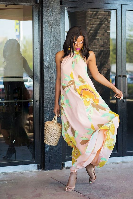 a pink floral print halter neckline maxi dress with nude shoes and a wicker basket bag for a fashion-forward lady