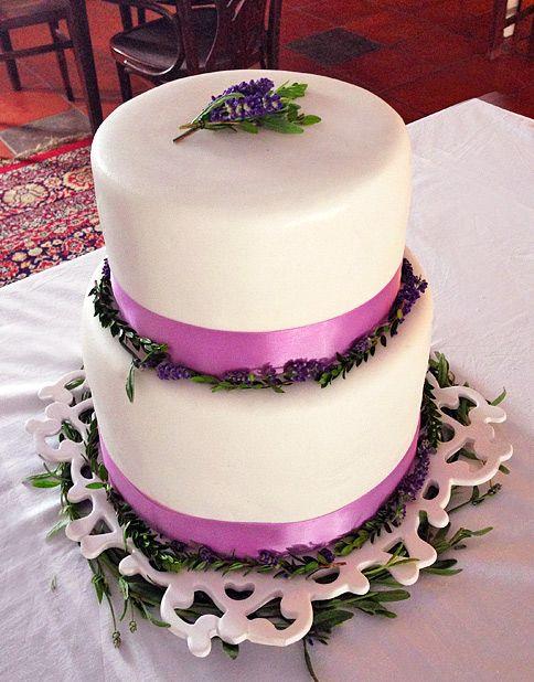 a vegan wedding cake with lime, lemon, vanilla and homemade creamcheese frosting plus fresh raspebrries
