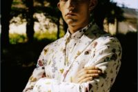 25 a white suit with a bright floral print and a matching shirt with no tie is a bold idea for a summer wedding