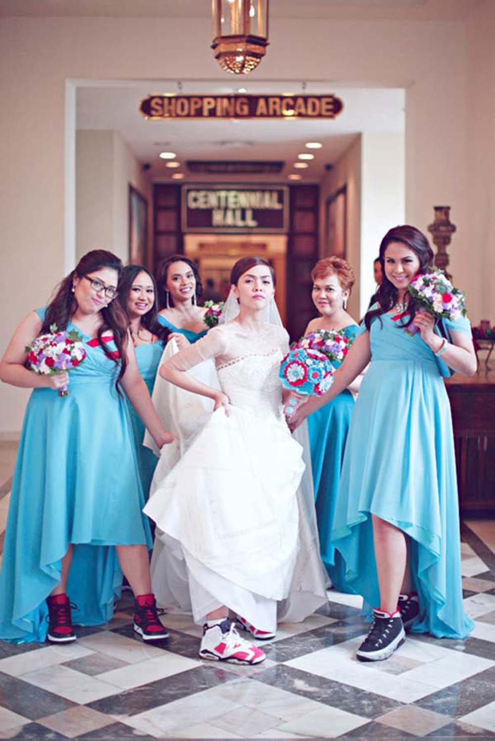 this sporty bride preferred colorful trainers for her wedding day and all the bridesmaids were wearing trainers, too
