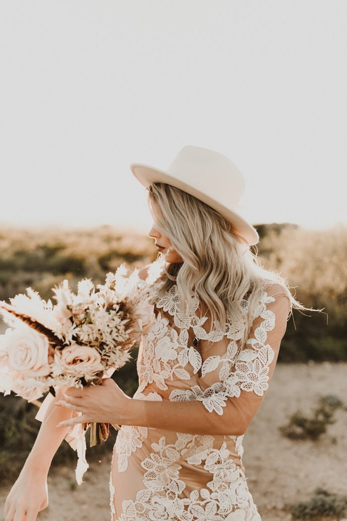 a chic boho lace wedding gown styled with a creamy fedora hat is a fantastic idea to rock