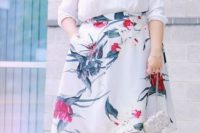 26 a white V-neckline shirt, a floral A-line asymmetrical skirt, metallic shoes and a clutch for a casual wedding