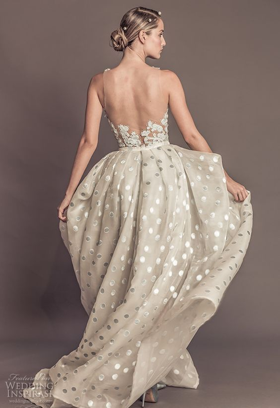 an off the shoulder wedding dress with a lace bodice, an illusion back and a shiny polka dot skirt