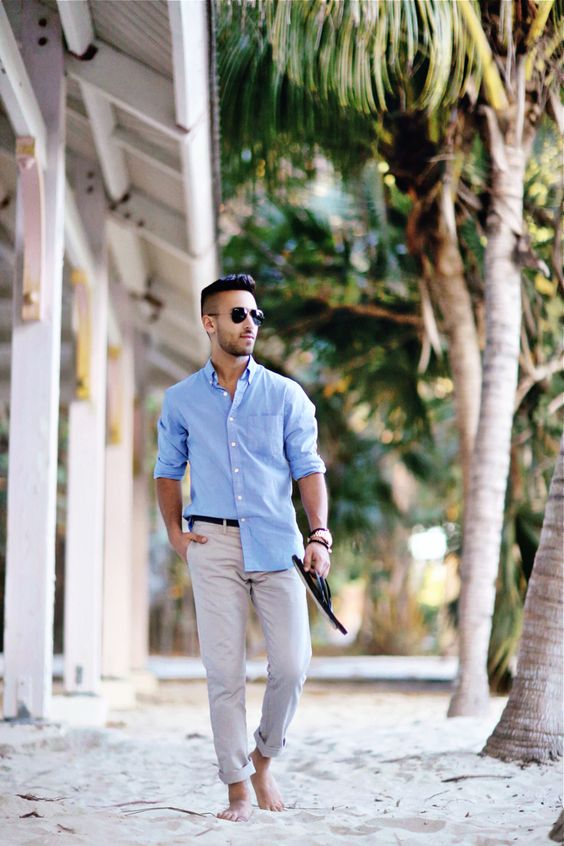 a blue shirt, neutral pants, aviators and flip flops that were given by the couple as a wedding gift