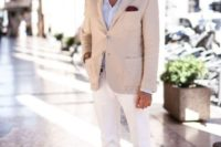 a chic look with a light blue shirt, a tan blazer, white pants, tan leather moccasins and sunglasses