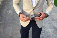 a classic yet modern look with navy pants, a white shirt, a creamy blazer and brown moccasins